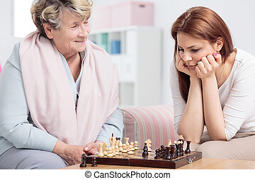 Grandmother playing chess with her