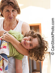 Grandmother playing with granddaughter