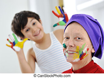 Grandmother playing with grandson at son