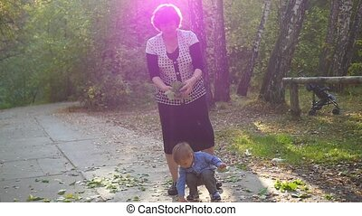 grandmother playing with grandson in Park