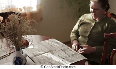 Grandmother reading a newspaper