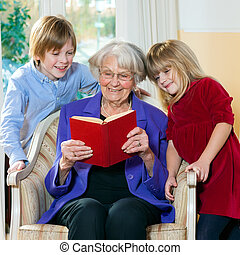 Grandmother Reading Book to Grand Children