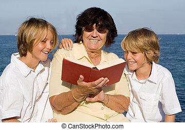 grandmother, reading book to grandchildren