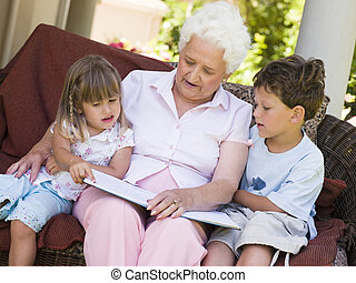 Grandmother reading to grandchildren