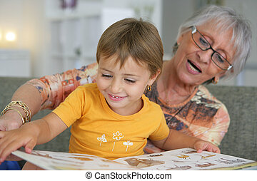 Grandmother reading with toddler