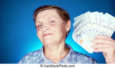 Grandmother smiling, she happy to get benefits with paper ...