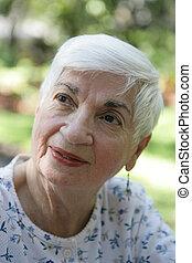 Grandmother - A closeup portrait of a sweet, beautiful...