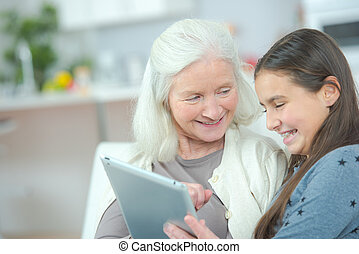 grandmother surfing the web with grand daughter
