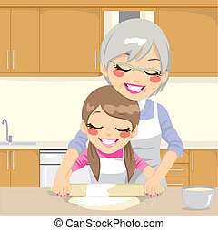 Grandmother teaching Granddaughter how to make pizza dough together in kitchen