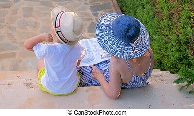 Grandmother teaching grandson. Preschooler is tutored by ...