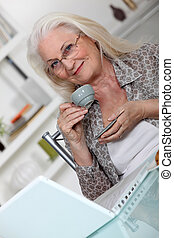 grandmother using laptop at home