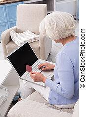 Grandmother visiting online store - Elderly woman orders...
