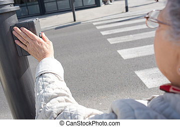 grandmother wanting to cross the street press the button