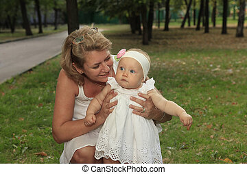 Grandmother with baby smiling