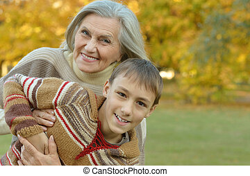 Grandmother with boy  in  park
