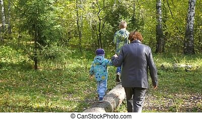 grandmother with children walking in the Park