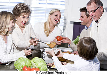 Grandmother with family laughing in kitchen - Grandmother ...