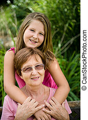Grandmother with grandchild - Outdoor lifestyle portrait of...
