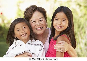 Grandmother With Grandchildren In Garden