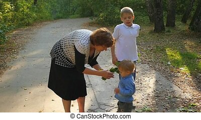 grandmother with grandchildren playing in the Park autumn...