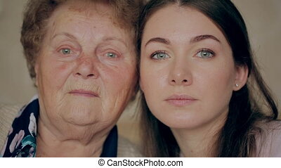 Grandmother with granddaughter face to face