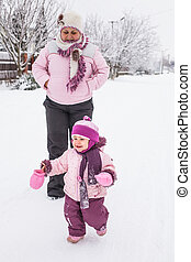 Grandmother with granddaughter for a walk