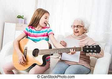 Grandmother with granddaughter singing together
