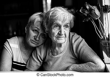 Grandmother with her adult daughter. Black and white photo.
