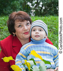 grandmother with her grandchild in autumn