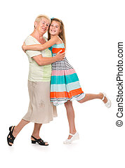 Grandmother with her granddaughter in the studio on a white...