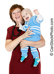 grandmother with her grandson in her arms in the studio