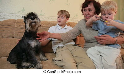 Grandmother with kids and pets