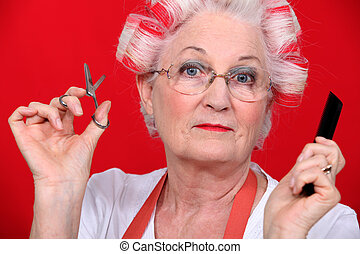 grandmother with scissors and haircurlers