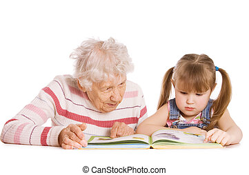 Grandmother with the grand daughter read