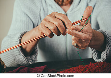 Grandmother's hands and memories of childhood. Preparing for the winter. Always fashion handmade clothing. Warm and cold colors of yarn. Knitting Tools for Beginners.