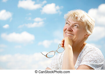 Grandmothers leisure - The elderly woman smiles and holds in...