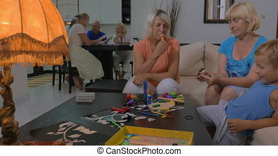 Grandmothers playing with grandson at home