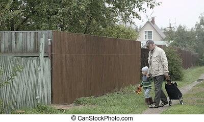 Grandpa and grandson coming into gate.