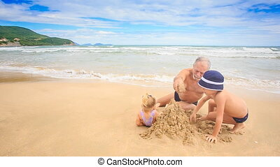 Grandpa Blond Girl Boy Model Castle with Wet Sand on Beach