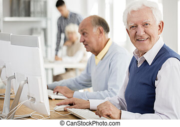 Grandpa enjoying computer classes - Happy grandpa enjoying...