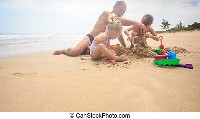 Grandpa Kids Play with Toys Sand on Beach by Wave Surf