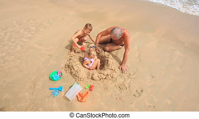Grandpa Kids Play with Toys Sand on Beach