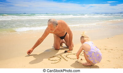 Grandpa Little Blond Girl Draw on Wet Sand of Beach by Surf