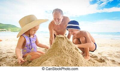Grandpa Little Girl Boy Spread on Sand Heap on Beach by Surf