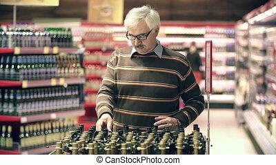 Grandpa Old Cough Medicine - Close up of adult man choosing...
