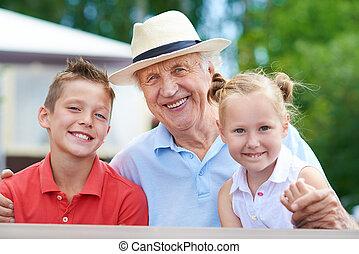 Grandpa - Portrait of a senior man with two grandchildren
