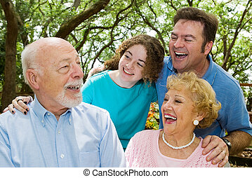 Grandpa Tells a Joke - Family in the park, laughing at a...