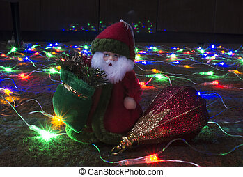 Grandparent Frost with toy on festoon of the lights
