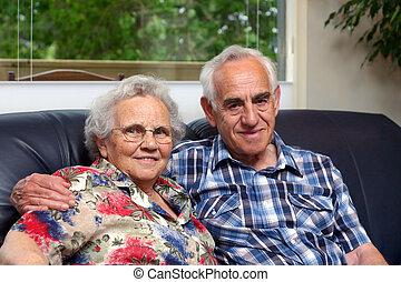 Grandparents - An elderly couple.