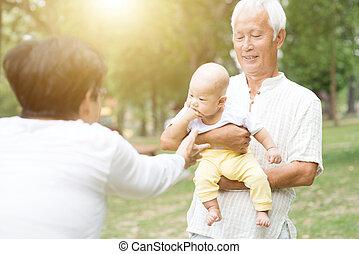 Grandparents and grandchild.